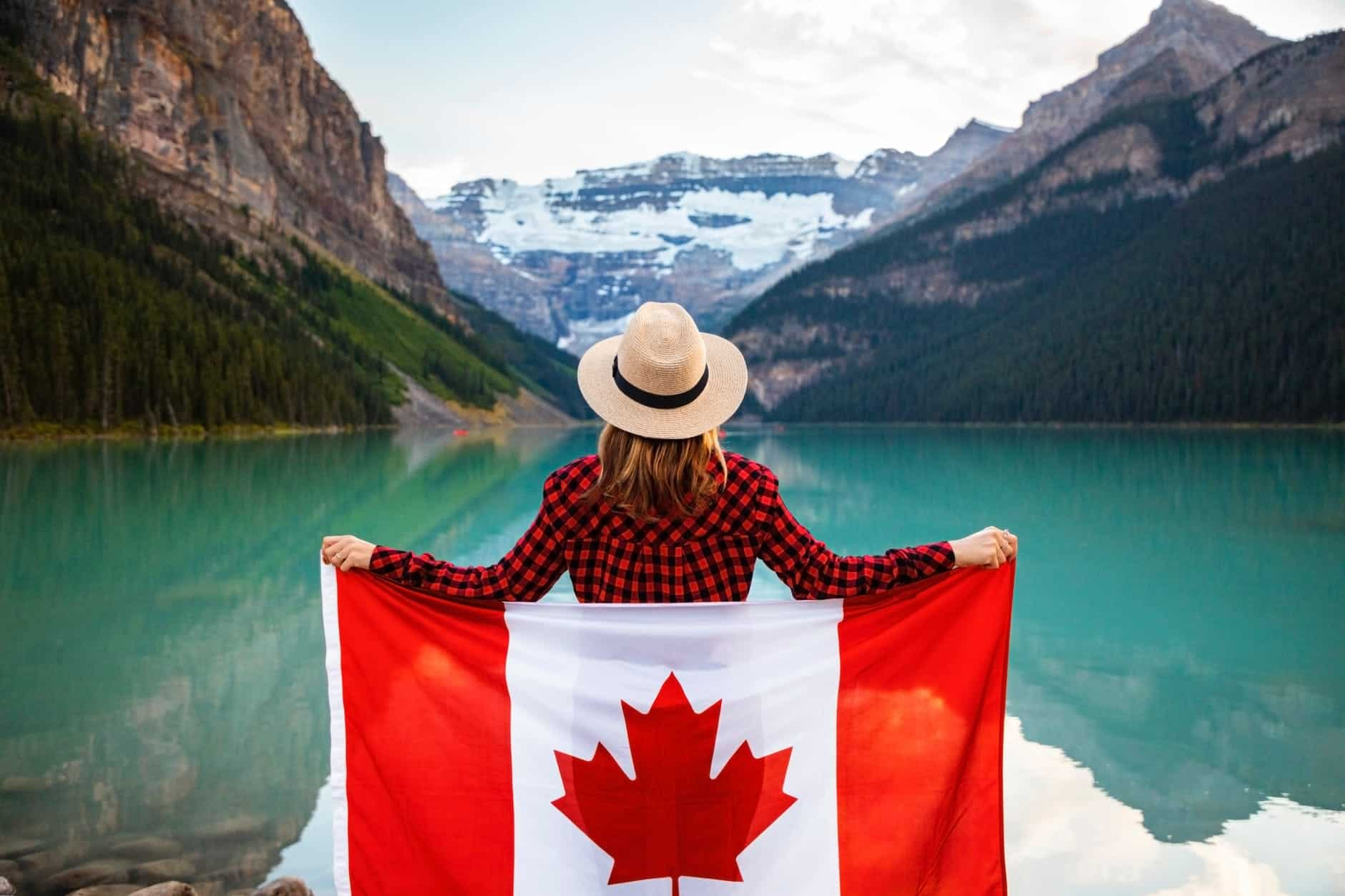 canada nature and canadian flag held by a woman I love veterinary