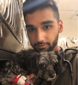 Aman Kanwar with dog patient in ER - I Love Veterinary